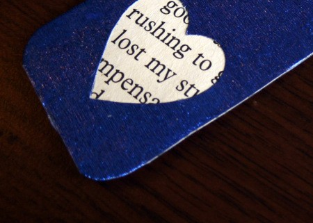 Punched Paper Bookmark - closeup of text through heart cutout