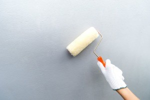 Hand glove holding paint brush