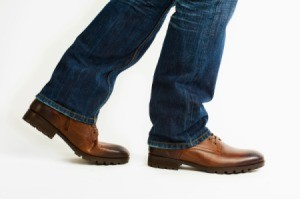 Close up of men's leather shoes walking.