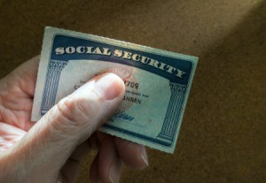 Hand holding Social Security Card.