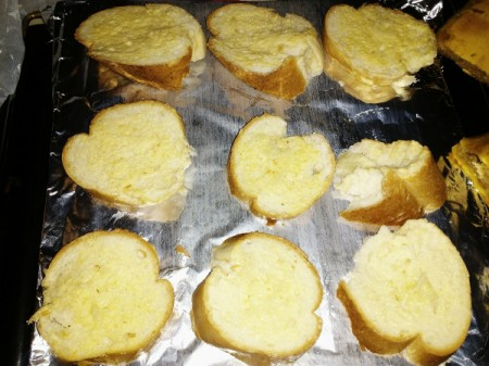 garlic bread pieces on foil lined pan