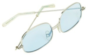 Tinted eye glasses on white.