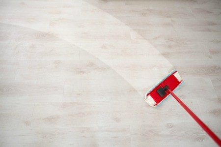 Mop cleaning a wooden floor.