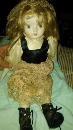 Doll Maker and Value  - doll with flowered dress, black bodice, and ivory blouse