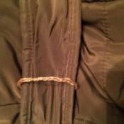 A belt loop on a jacket.