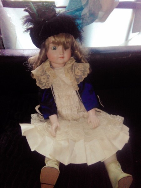 Value of Porcelain Doll - doll wearing a lacy dress