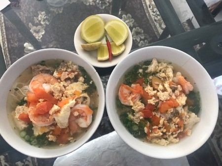 Vietnamese Shrimp, Pork and Egg Noodle Soup (Bun Rieu) in bowls
