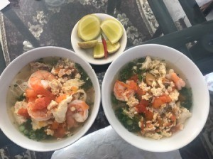 Vietnamese Shrimp, Pork and Egg Noodle Soup (Bun Rieu) in bowls