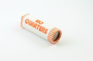 Roll of quarters on white background.