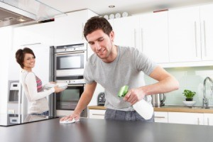 Man using Homemade Softscrub in the kitchen