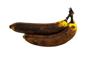2 overripe bananas on white background.