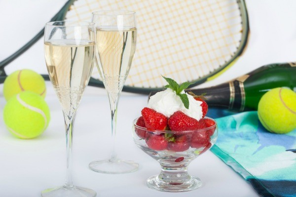 Table with tennis racket and balls strawberries and ch&agne. & Tennis Banquet Decoration Ideas | ThriftyFun