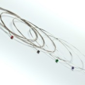 Unstrung Guitar strings on white background