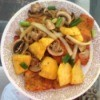 Salmon Topped with Pineapple and Mushrooms on plate