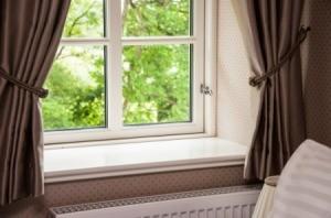 Window with dark curtains.