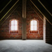 Empty Attic with two small windows.