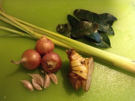 Asian herbs and seasonings: lemongrass, kaffir lime leaves, shallots, garlic and galangal.