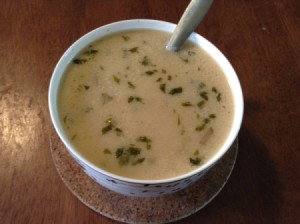 A bowl of creamy Tom Kha Gai soup.