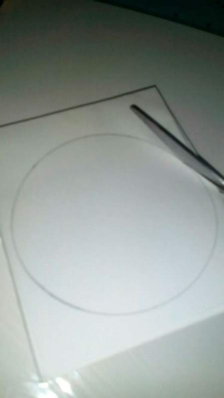 Cutting Duplicate Paper Shapes - cutting out the circles