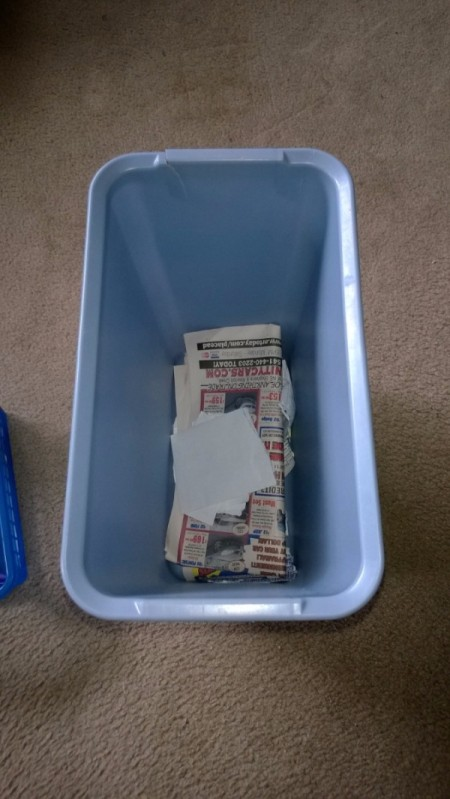 A trash container for paper recycling.