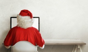 Santa typing on a computer.