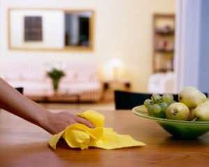 Hand wiping down a dining room table