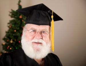 Santa wearing a graduation cap.