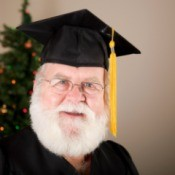 Santa wearing a graduation cap.