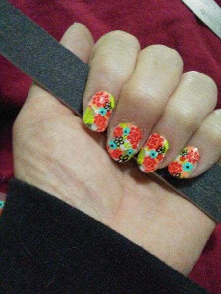 A finished set of acrylic nails.
