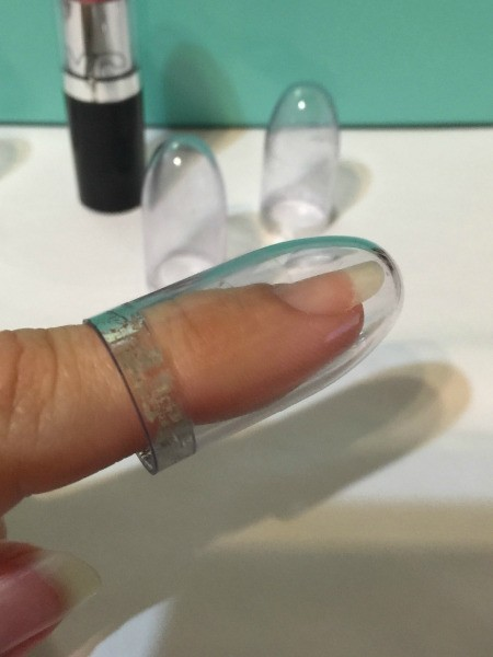 Use Lipstick Cap as Thimble - clear plastic cap over finger