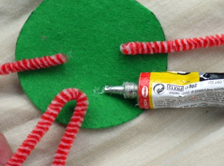 One Eyed Monster Badge - bend long pipe cleaner in half