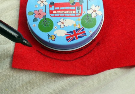 One Eyed Monster Badge - use circular lid to help make a mouth on red felt