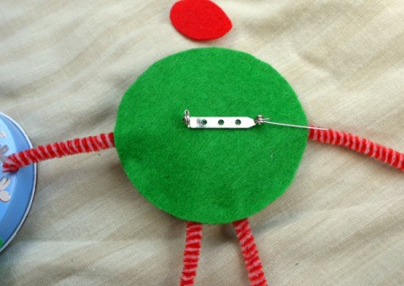 One Eyed Monster Badge - stick pin back to back side of monster