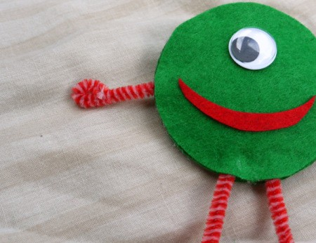 One Eyed Monster Badge - curl the ends of the arms to make hands