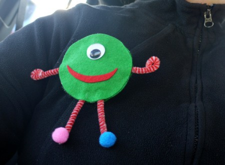 One Eyed Monster Badge - badge pinned on