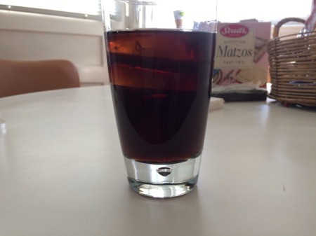 Large ice cubes in a glass of soda.