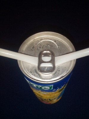 A straw placed under a ring tab.