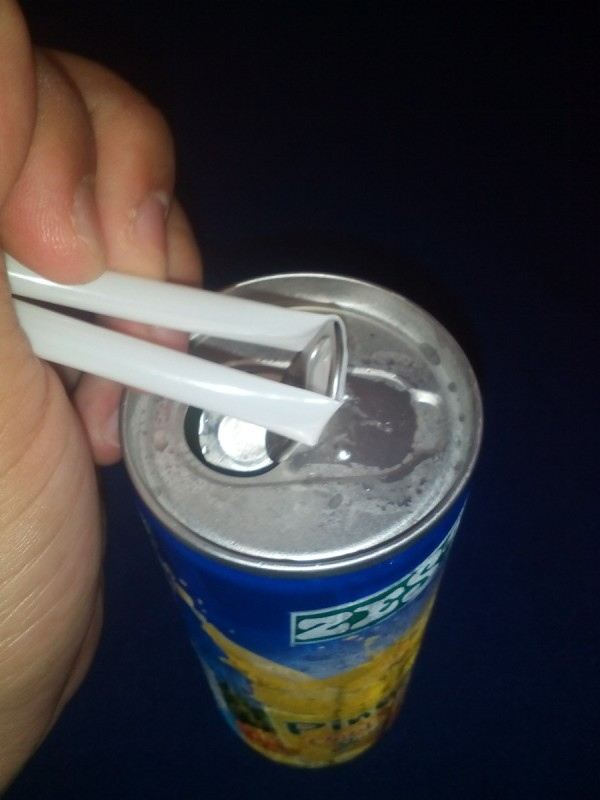 A straw placed under a ring tab to open it.
