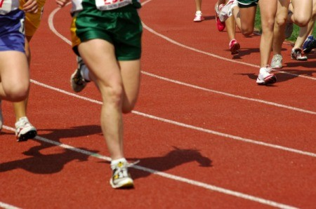 People running at a high school track meet.