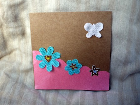 Greetings Card With Stickers - arrange embellishments along the wavy line and stick one in the upper corner