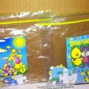 Two children's puzzles in plastic bags.