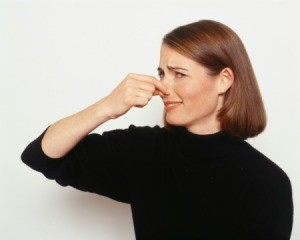 A woman holding her nose.