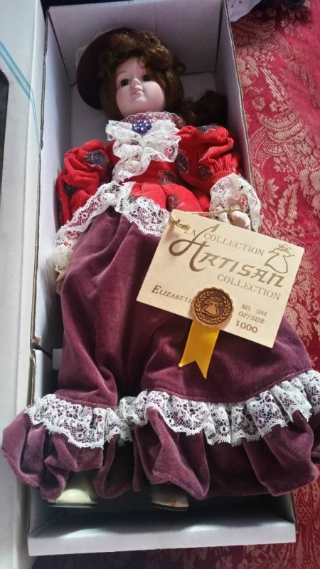 Information on Porcelain Doll - doll in box, wearing a red and purple period outfit