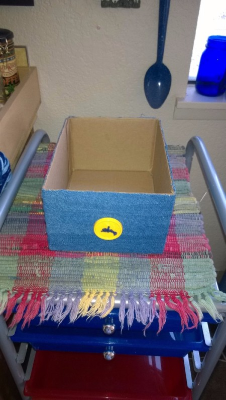 Craft Project Tickler Box - continue adding rows of fabric, glue button decoration to front