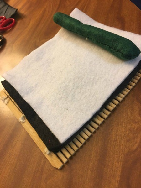 Sushi Plush Toy - place green tube on top of white and black felt