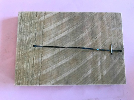 Bobby Pin Thumb Piano - bobby pin stapled to edge of wood