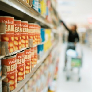 A row of canned goods at the supermarket