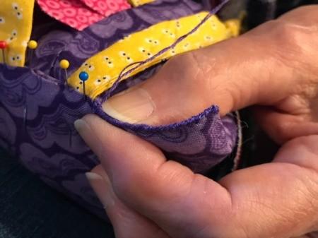 Fabric Chicken Doorstop - closeup of sewing bottom shut