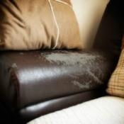A worn brown leather sofa.