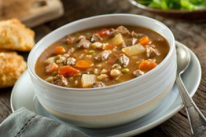 A bowl of beef barley soup.